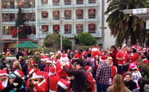 Macy's shoppers mingle with Santas' helpers.