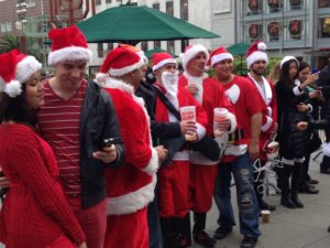 Mirth flows freely among Santas friends.