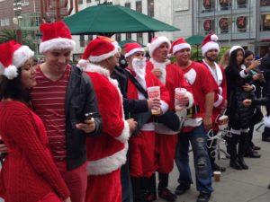 Mirth flows freely among Santas friends.