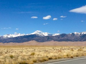 The road, the high desert, the sand dunes, the snow-capped mountains.