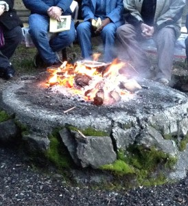 The campfire around which we gathered on damp logs at Easter dawn.