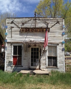 Back in gold mining days, this was Crestone's hardware store. Note the pick-axes above the flag.