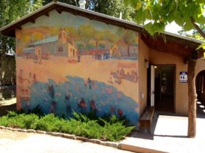 A mural of the Chimayo Church compound