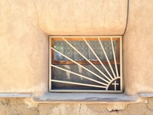 A window on the side of the  Chimayo Sanctuario