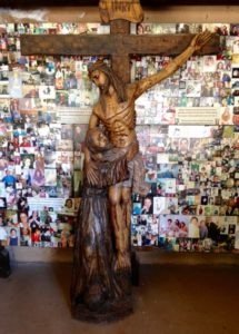 An unusual crucifix on the Chimayo grounds: note that Christ is shown with one arm reaching down from the cross to