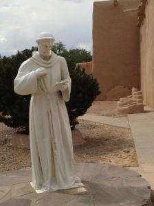 One of my favorite photos: St. Francis checking for text messages from the Pope.